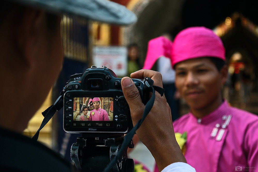 Photographer is taking a photo of just married couple in Mandalay, Myanmar