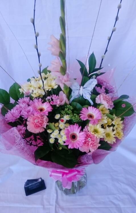 Pastel pink and lemon hand tied