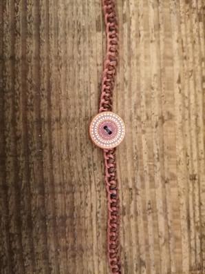 Brown circular button
