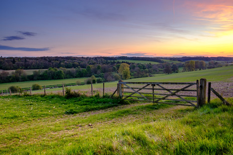 Sunset over field gate in the Chess Vall