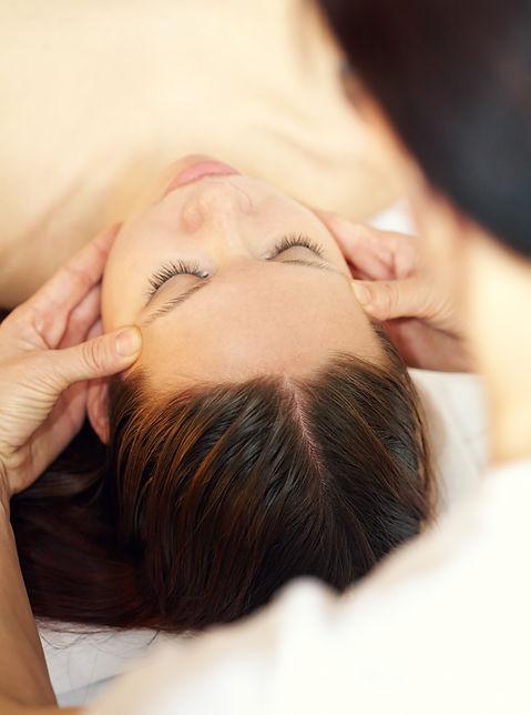 Therapist making acupressure head massag