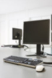 bigstockphoto_Two_Computers_In_An_Office