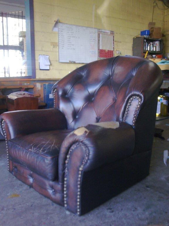 Before: Antique leather armchair