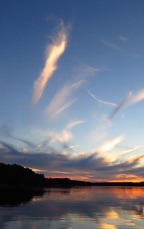 Clear evening sunset with wispy clouds.j