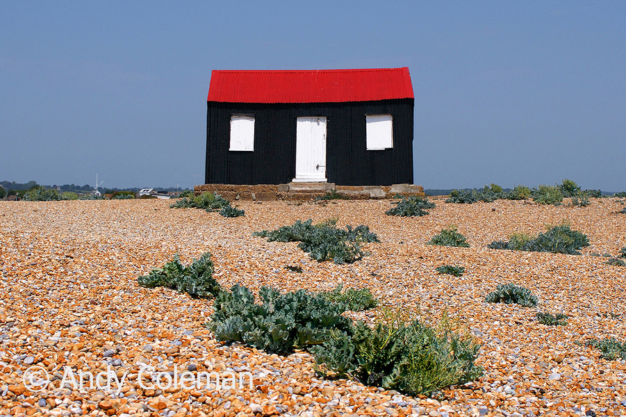 A colourful hut or shed on a beach near Rye Harbour in East Sussex, UK.