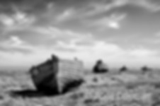 Old wooden boats on the unique, bleak, shingle shore peninsular at Dungeness in Kent.