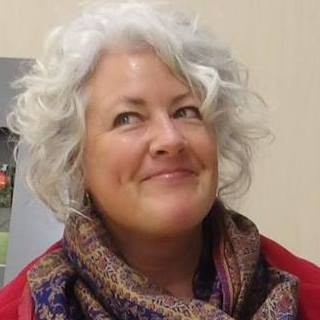 Dr Annetta Mallon is a woman with white curly hair, a cheeky smile, and in this picture her eyes rolled up and to the side - because someone just asked her if her job is about 'euthanasia'. Again...