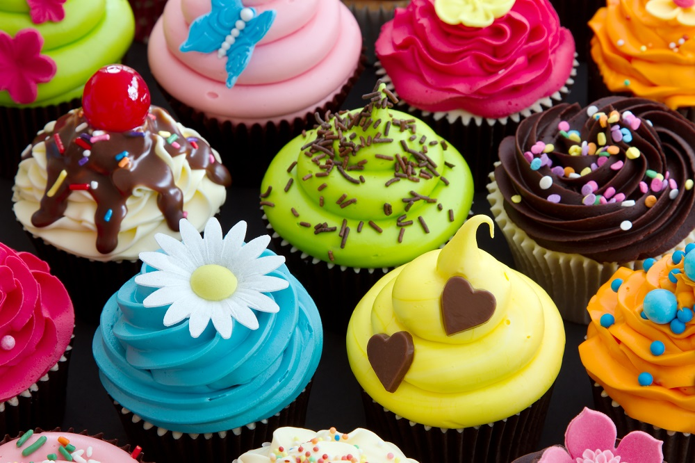 Colourful or branded cupcakes.
