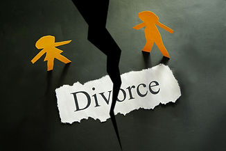 torn piece of paper with divorce text an