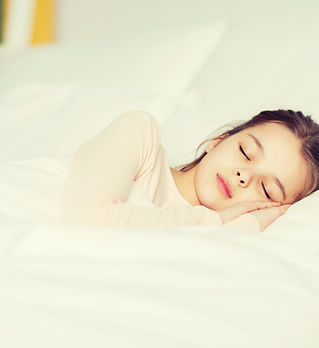 girl-sleeping-in-bed-at-home-PC9EJXP.jpg