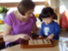 Child lplaying with montessori materials