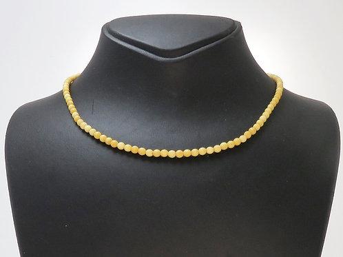 שרשרת לצוואר עשויה מחרוזי עצם עגולים המושחלים על חוט מנעול מקורי שנות ה - '30 aaronjewelryart.com