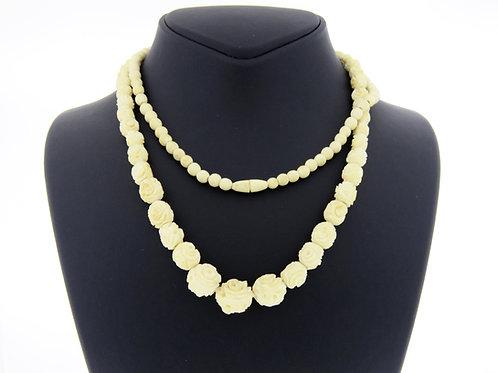 שרשרת חרוזים מדורגים עשויים עצם חלקם מגולפים כשושנים וחלקם עגולים שנות ה - '30  aaronjewelryart.com