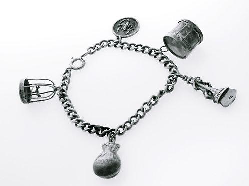 צמיד צ'ארם וינטג' מכסף סטרלינג 925 עם 5 קמעות מזל בנושא עולמי בעבודת יד aaronjewelryart.com