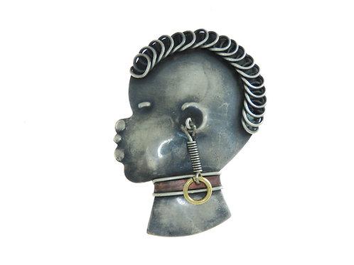 סיכת כסף עתיקה ארט דקו ראש נערה אפריקנית מכסף 800 ופס נחושת פולין שנות ה-'20 aaronjewelryart.com