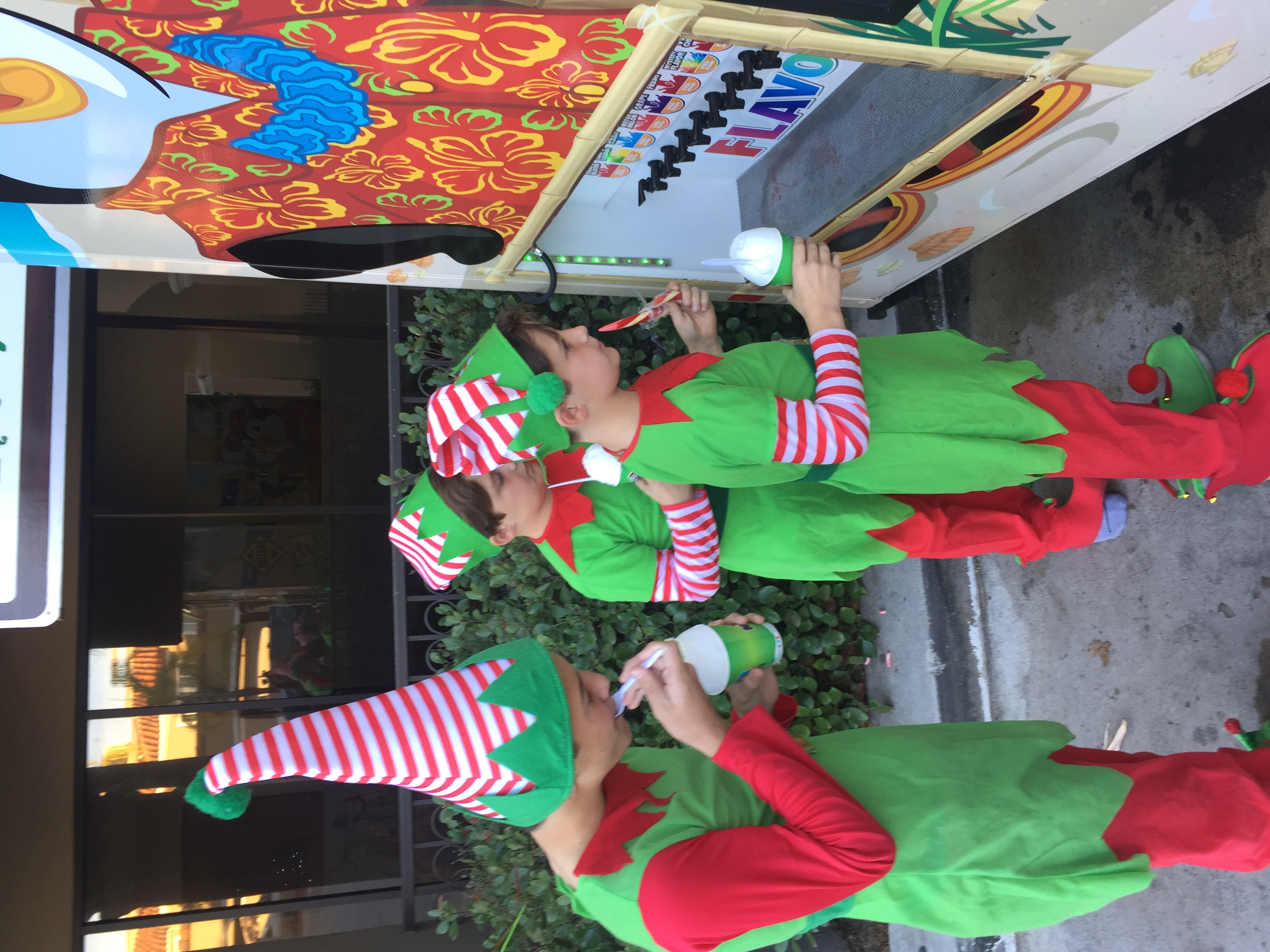 Elves trying the shaved ice flavors