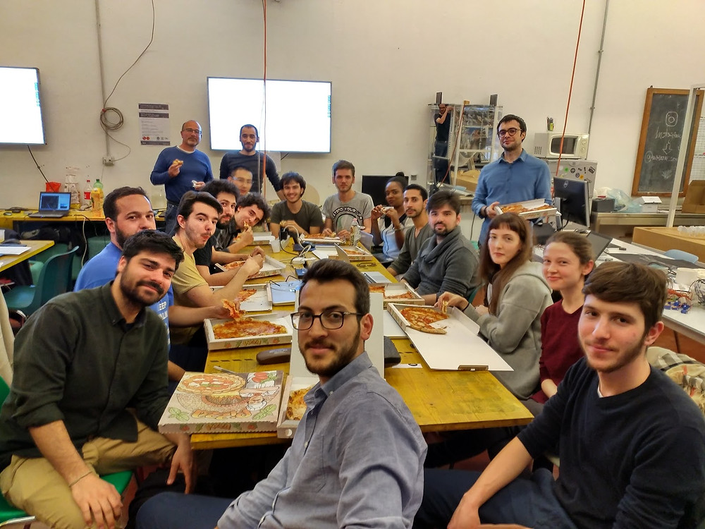 The PoliMappers team while eating a well-deserved pizza!