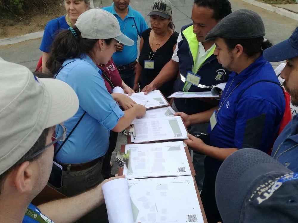Community members, GW and PADF staff gather in Ciudad Satélite to begin the building and household survey and validate data with Field Papers
