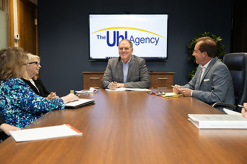 The Uhl Agency talking with team members