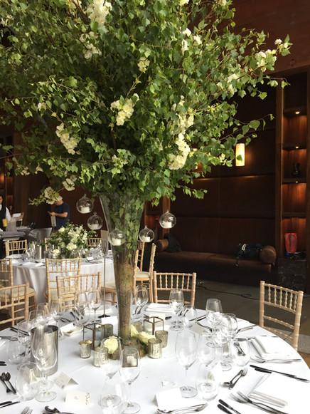 Wild foliage high table centres