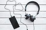 black-headphones-with-mobile-smartphone-