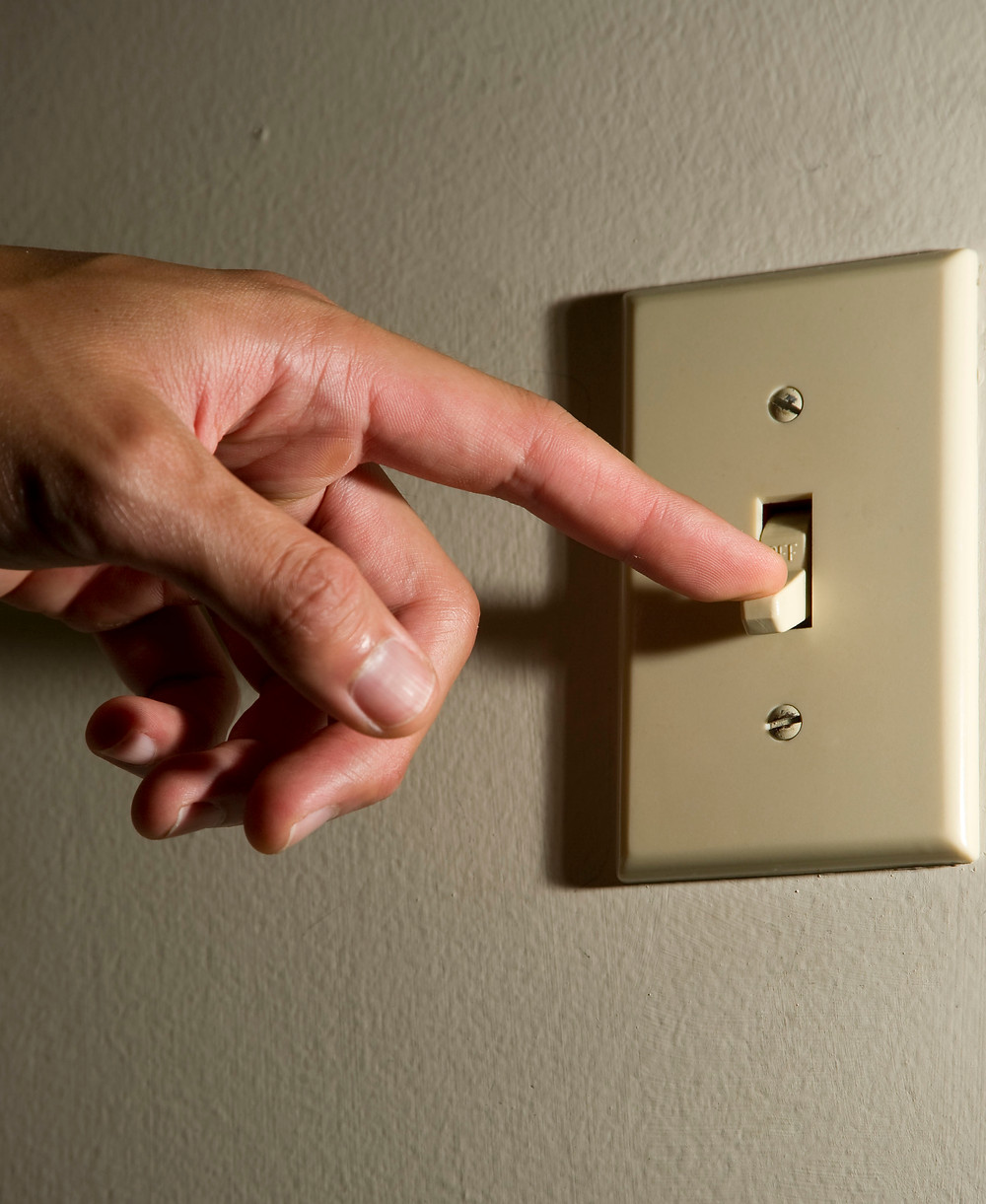 Reduce Emissions | Hand turning off lightswitch