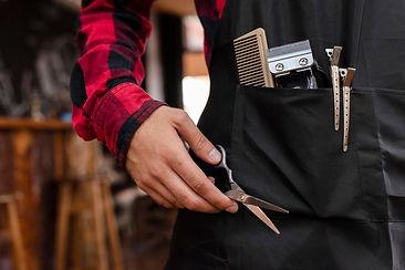 close-up-barber-tools-black-apron_23-214