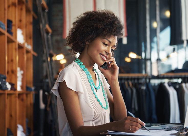 black business owner filling out paperwork - hemisphere