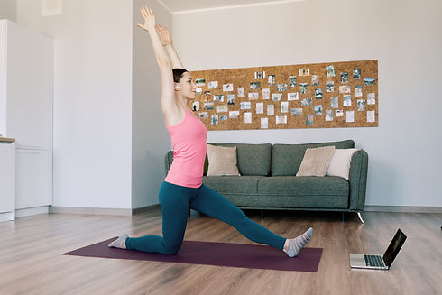 caucasian-woman-practicing-yoga-home.jpg