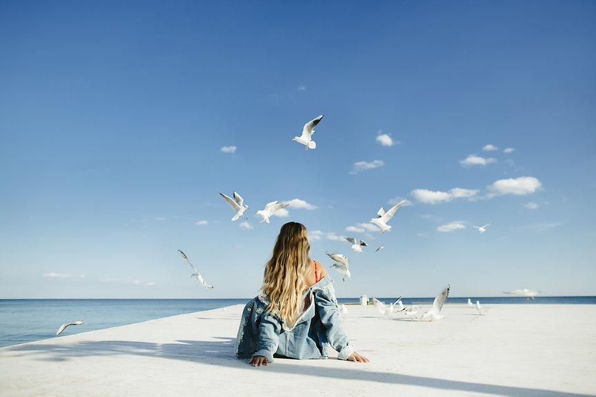 girl-sits-berth-watch-seagulls 2.jpg