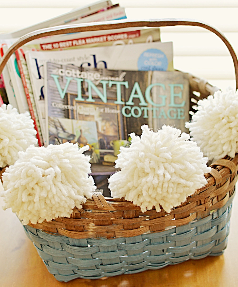 Vintage basket with pom poms and blue paint