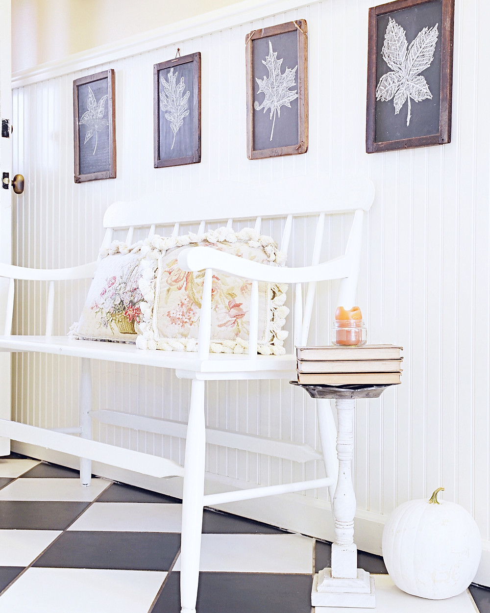 Entryway decorated for fall with vintage children's