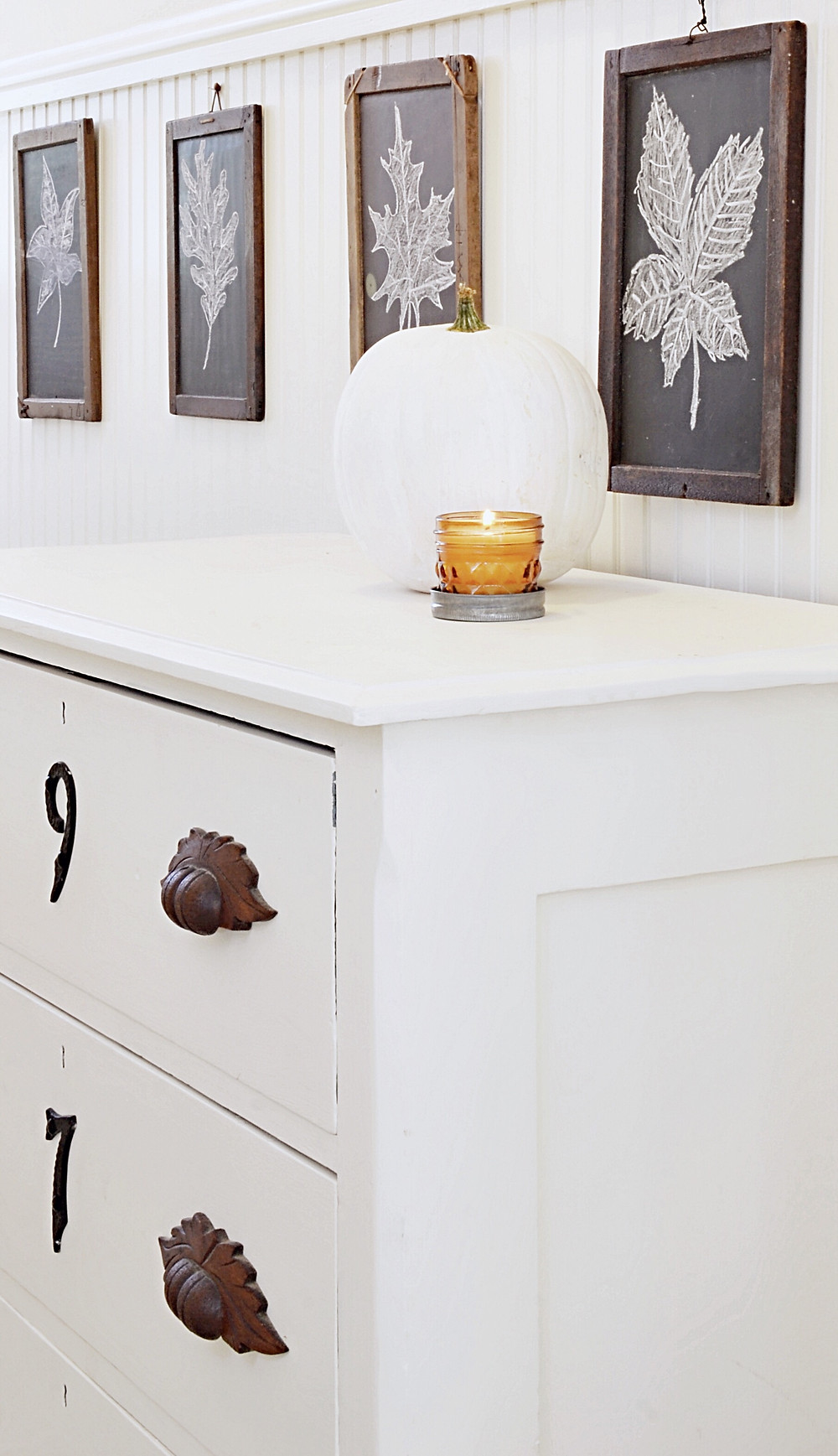 Antique children's slate in entryway with fall decor.