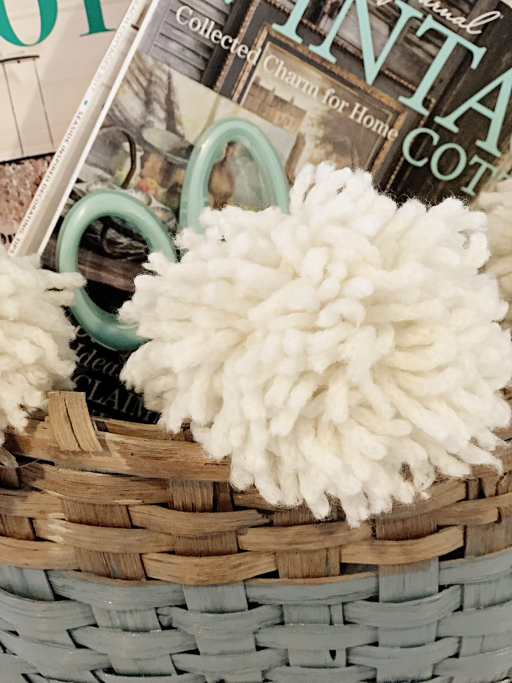 vintage basket with white pom poms
