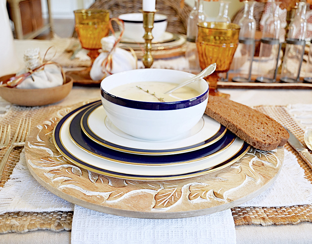 Table scape with Vermont Cheddar Cheese Soup and bread.