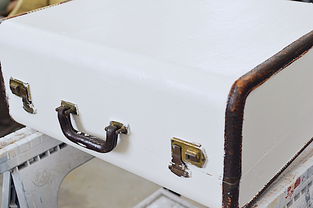 Vintage painted white suitcase