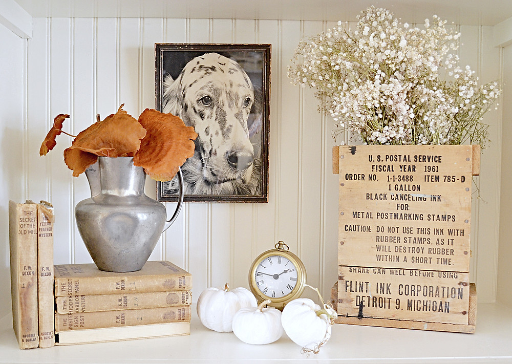 Vintage fall shelfie with fall decor.