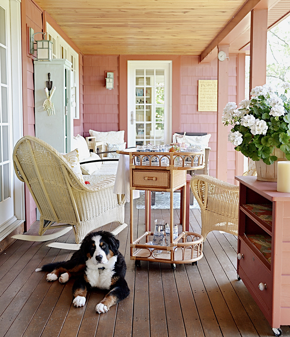 Porch styled in vintage decor.