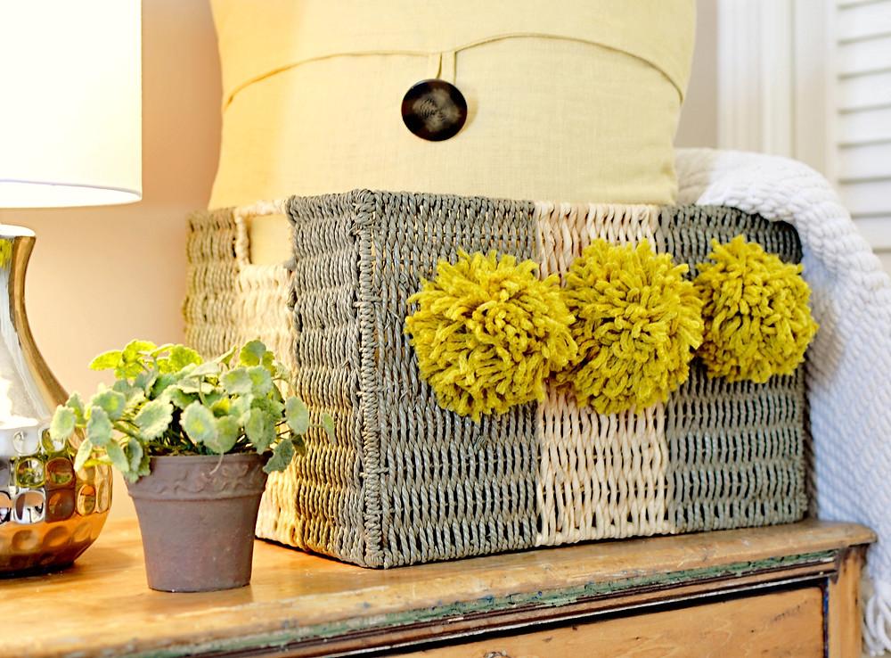 striped basket with pom poms