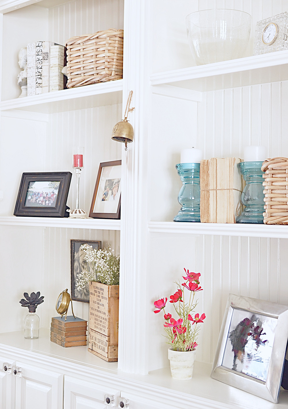 Built-Ins styled with vintage books, baskets, candles and more.