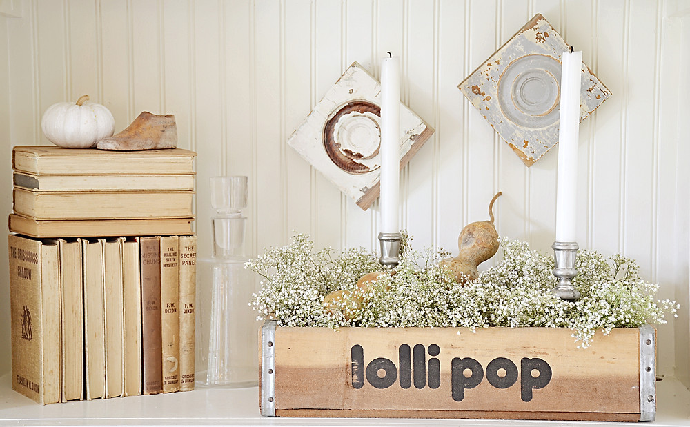 Vintage lolli pop crate and vintage book collection.