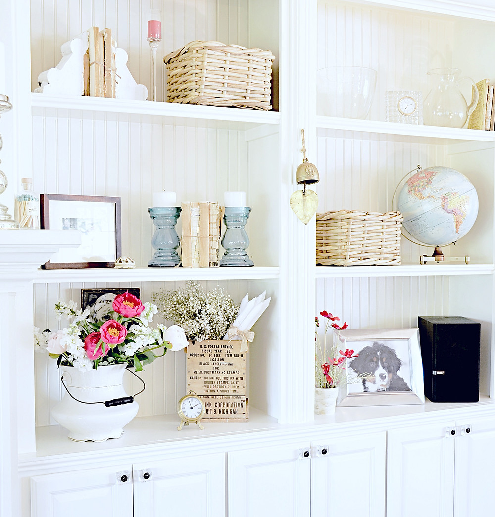 Decorated shelfie builtins with vintage finds.