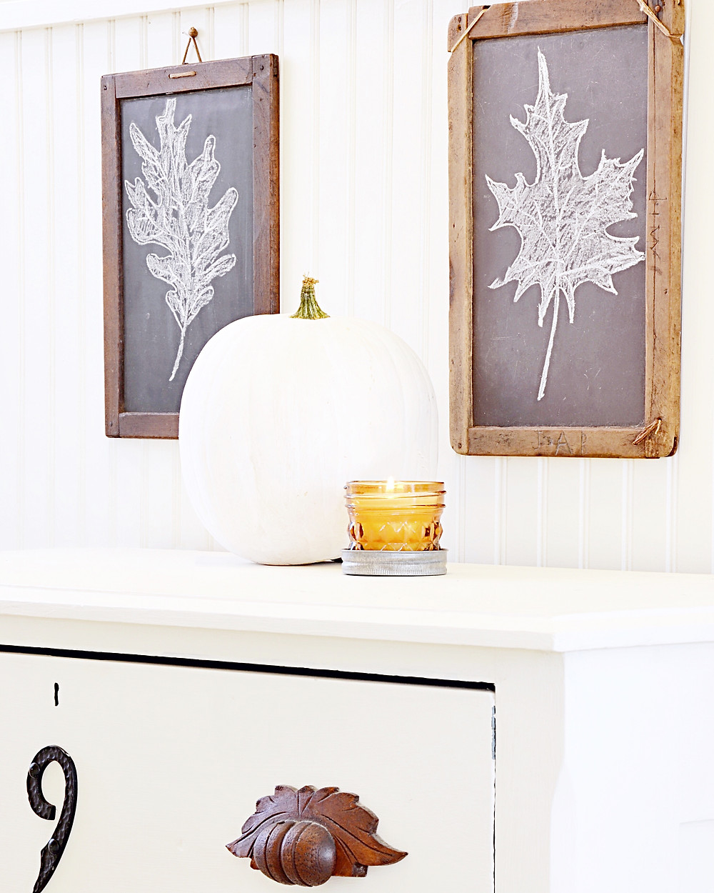 Antique children's chalkboards with fall decor.