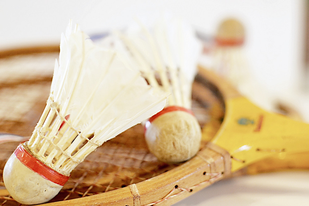 Vintage badminton birdies and racquets.