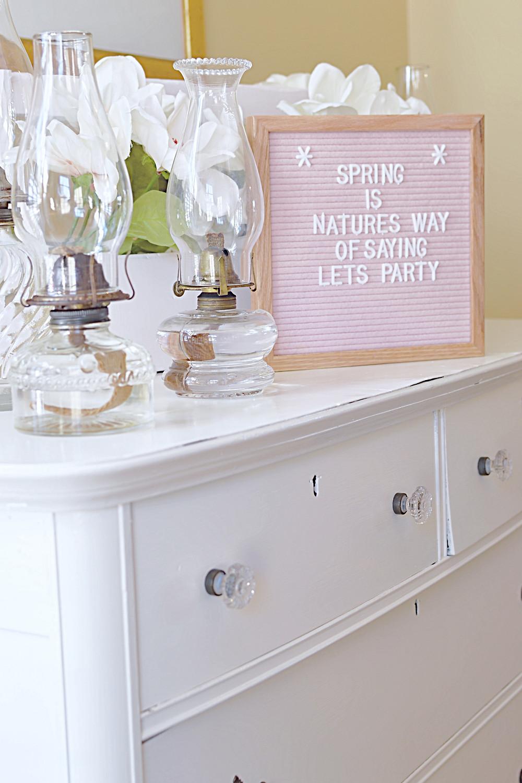 Vintage bureau with Pink Felt Letter board and vintage oil lanterns.