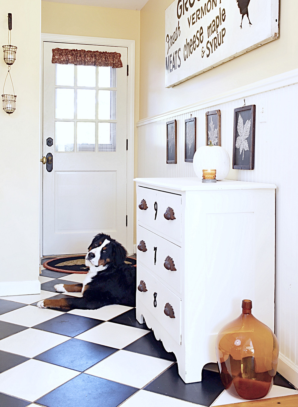Entryway decorated for fall with vintage charm.