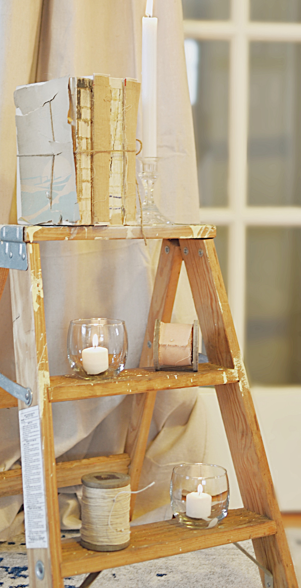 Step ladder with vintage books, candle and more.