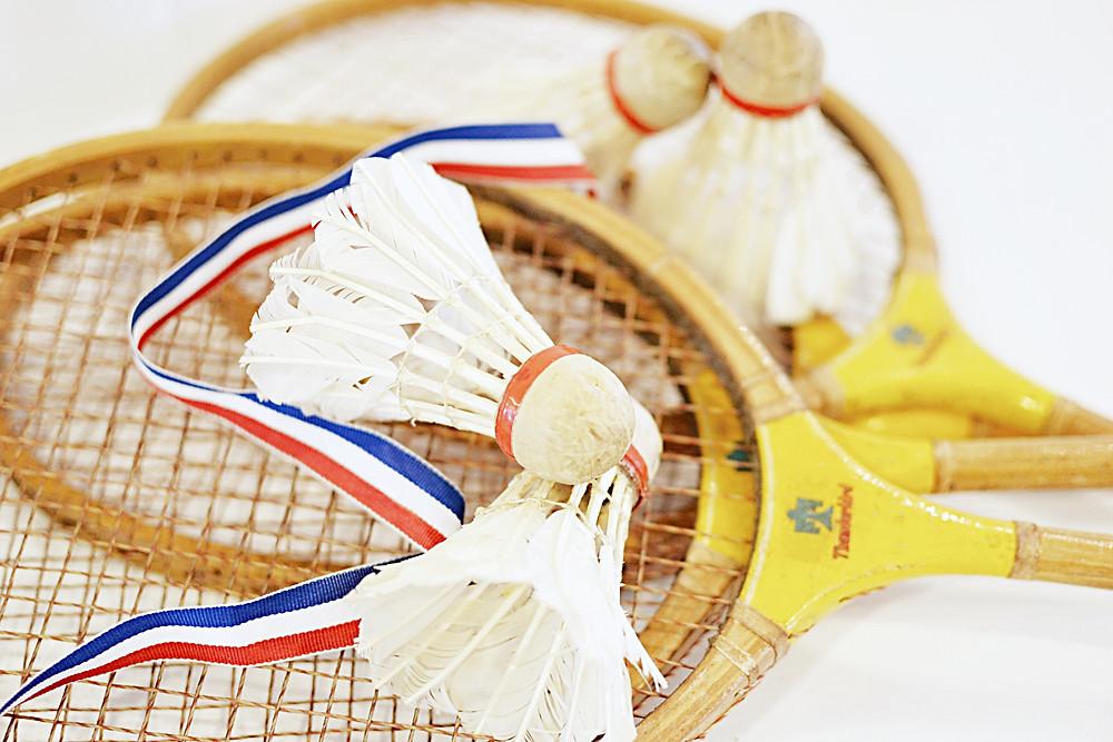 Vintage badminton racquets, birdies and ribbon.