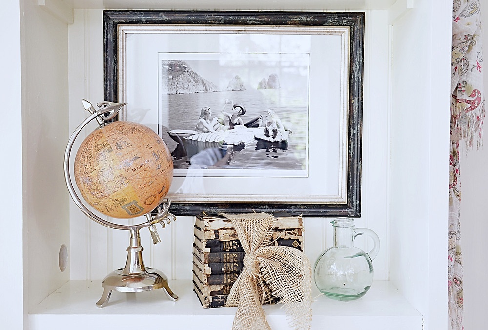 Picture hanging on shelfie wall w/ vintage style.