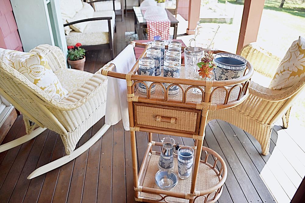 Vintage beverage cart with vintage cocktail set on the porch.